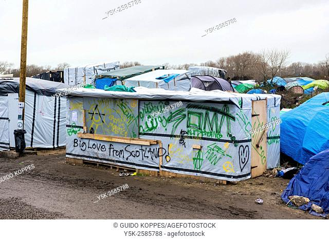 Calais, France. Makeshift shed with slogan inside the camp for illegal migrants, bound for the UK