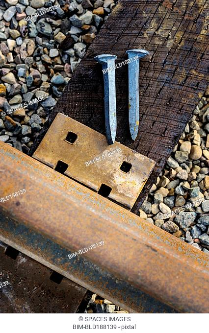 Close up of railroad tracks and rail spikes