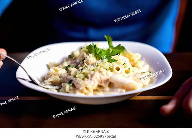 Close-up of athlete eating pasta dish