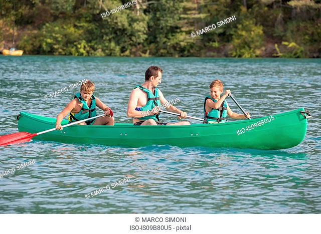 Father and sons in canoe, Esparron-de-Verdon, Provence Alpes Cote d'Azur, France, Europe