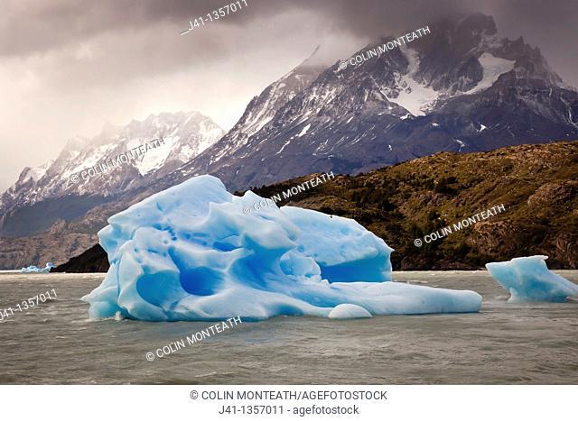 Blue iceberg, rain squalls on Lago Grey, Parque Nacional Torres del Paine, Patagonia, Chile