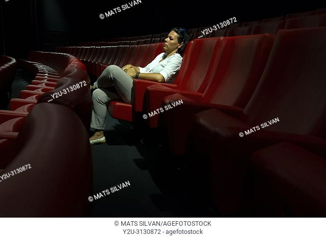 Woman Sitting Alone in Movie Theater