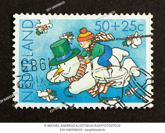 HOLLAND - CIRCA 1980: Stamp printed in the Netherlands shows a flying snowman, circa 1980