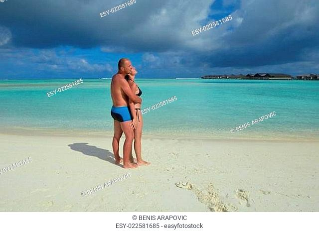 happy young couple at summer vacation have fun and relax at beach