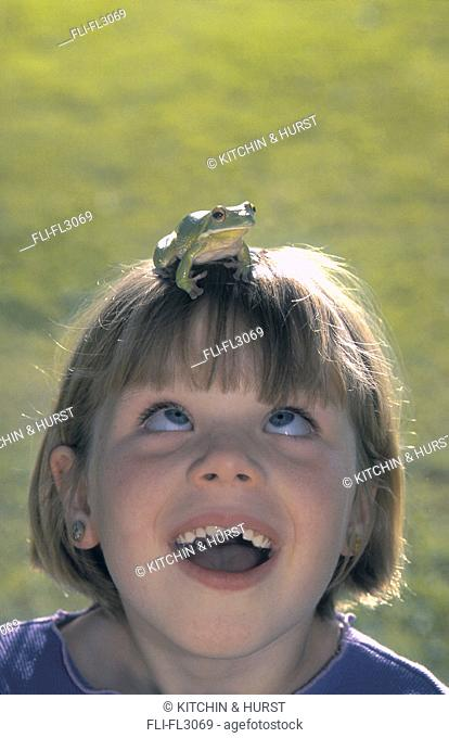 Girl with green frog on head