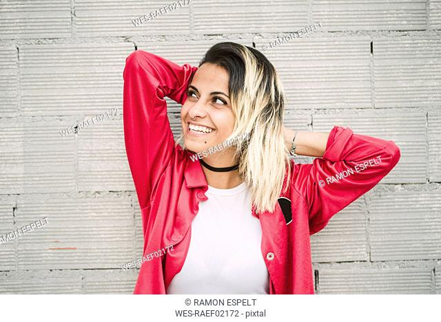 Smiling young woman portrait, Spain