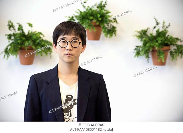 Man wearing trendy blazer and glasses, portrait