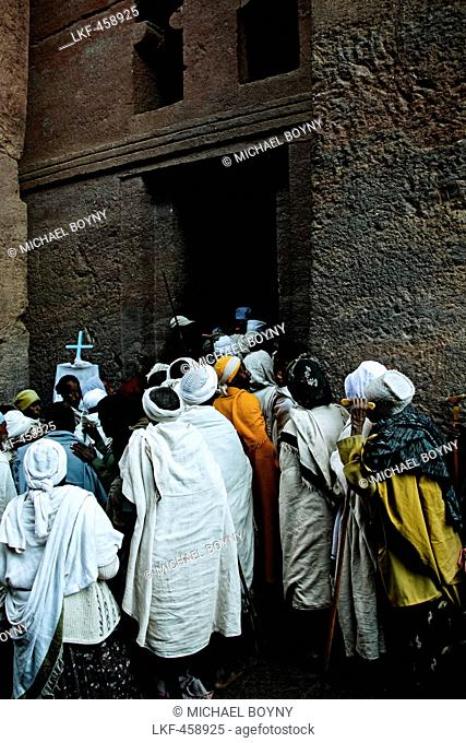 Priests entering a church in Lalibela, Ethiopia, Africa