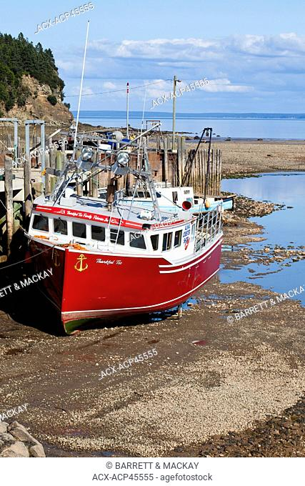 Fishing boat at low tide, Alma, New Brunswick, Canada