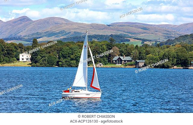 Sail boat on Lake Windermere in the Lake District, county of Cumbria, Ireland. The Lake District is a UNESCO World Heritage Site