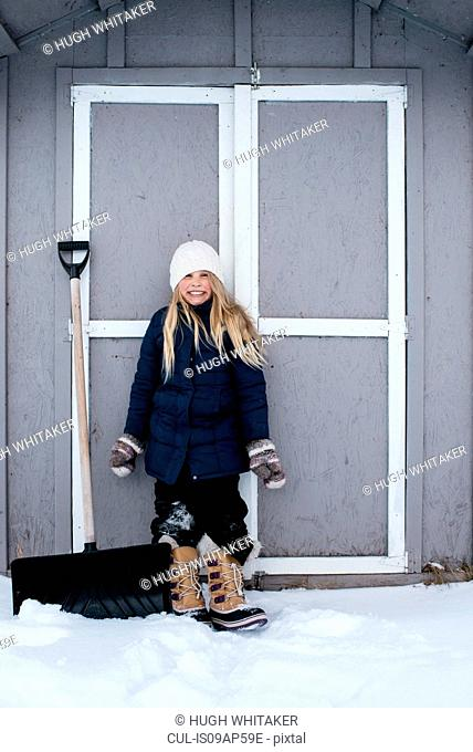 Girl grinning with excitement at snow