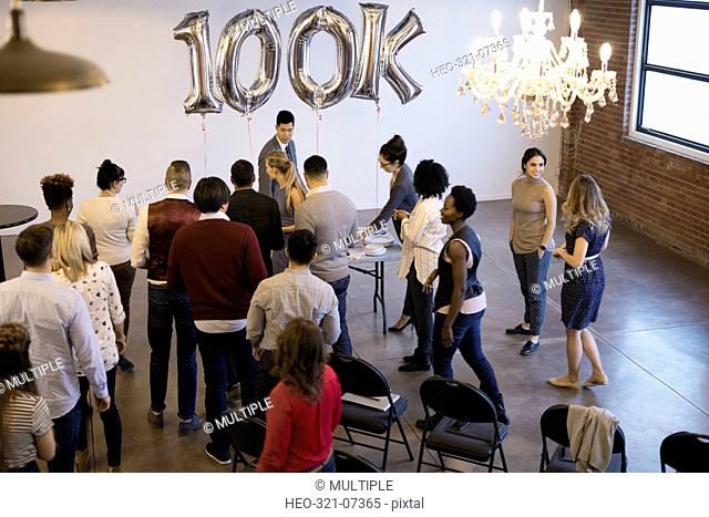 Business people networking celebrating milestone in conference room
