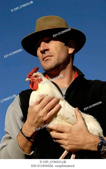 man and chicken