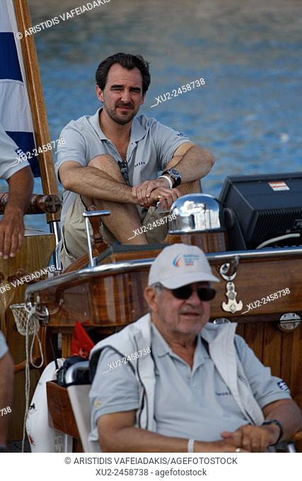 """King Constantine of Greece, and his son Prince Nikolaos on their traditional boat """"""""Afroessa at the port of Spetses island during the """"""""Spetses Classic Yacht..."""