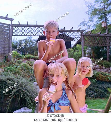 Blonde Children eating Popsicles - Garden - Summer