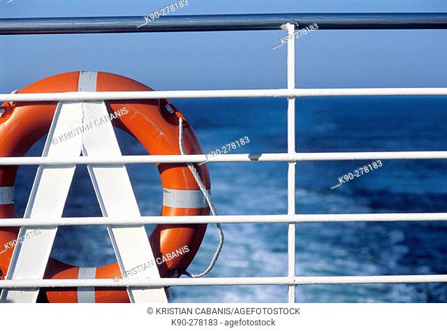 Life-belt at ferry. North Sea, North Germany