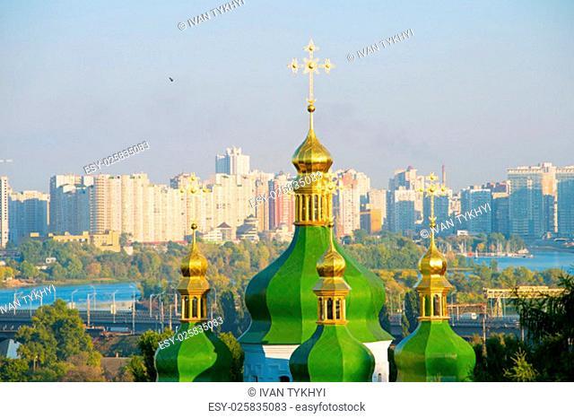 View of Vydubychi Monastery cupola and modern Osokorky district on the background. Kiev, Ukraine