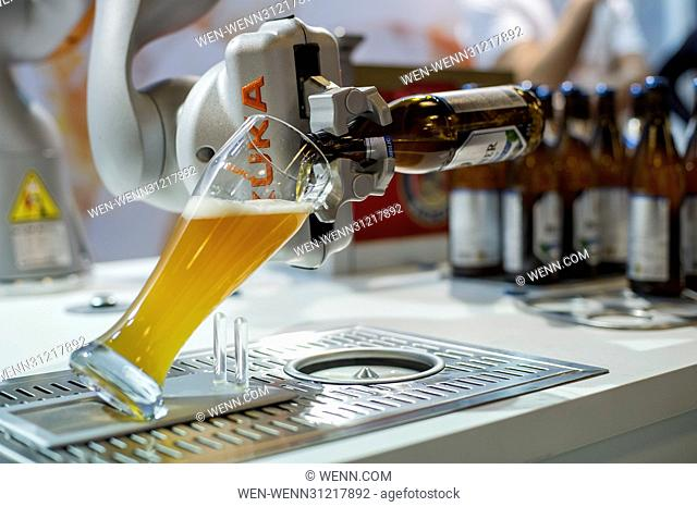 German company Kuka presents the LBR iiwa which can open and pour a glass of beer (Light Weight Robot)  at the European Robotics Forum in Edinburgh