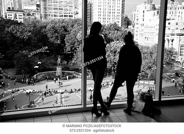 Two young woman front Union Square in Manhattan, New York, United States