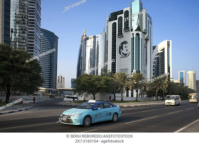 Taxi in Al Corniche street in the financial area of Doha, the capital of Qatar in the Arabian Gulf country
