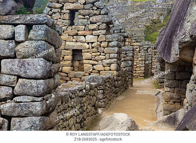 Deserted passageway between residential buildings in the settlement of Machu Picchu, Peru