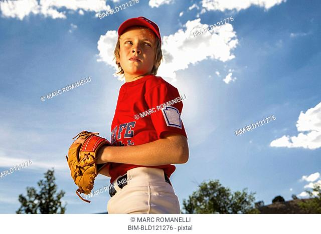 Caucasian boy playing baseball outdoors