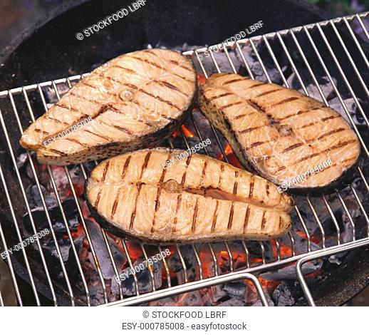 Grilled salmon cutlets on the grill