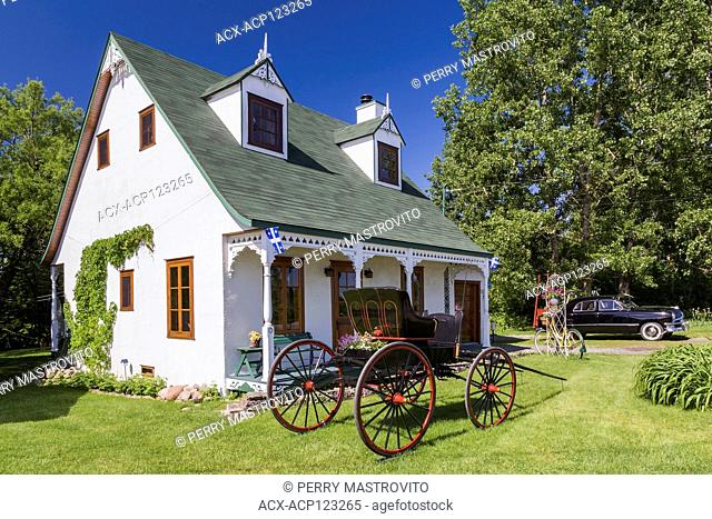 Old 1927 white stucco with green trim Canadiana cottage style home facade with black and red 1925 Greyson Campbell horse-drawn carriage and black 1950 Ford...