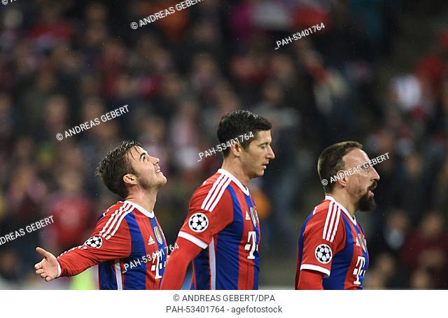 Munich's Mario Goetze (l-r), Robert Lewandowski and Franck Ribery celebrate his 2-0 goal during the Champions League group E match between FC Bayern Munich and...