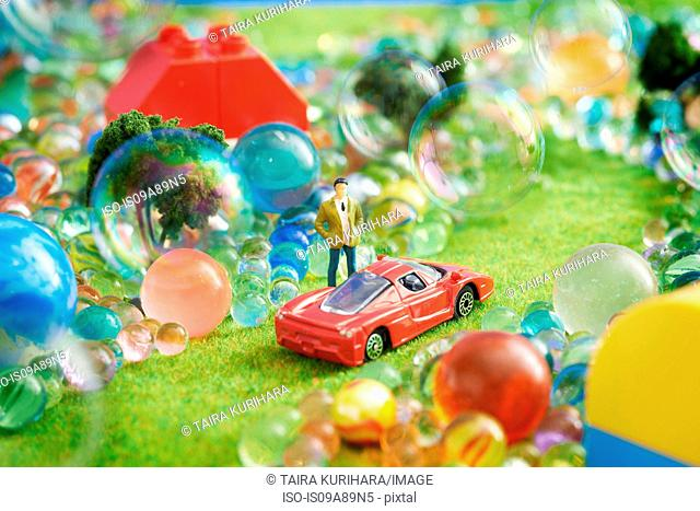 Toy car and figurine with bubbles