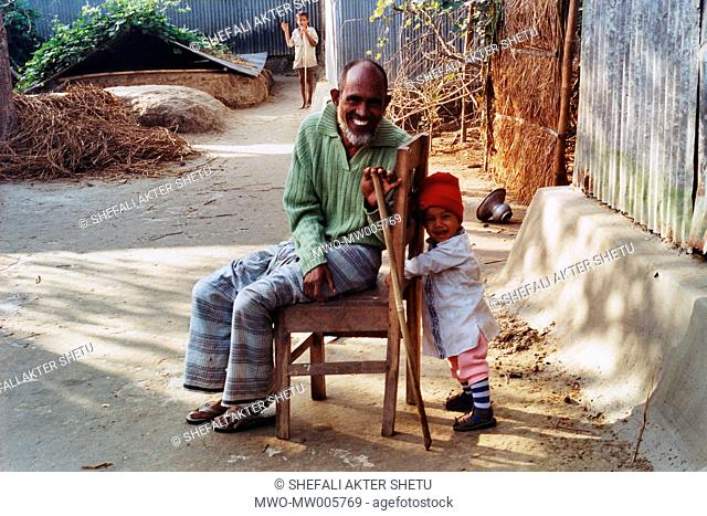 Past and future generation Grandfather late Abdul Barek Mia and grandson Shourab They used to live in Dhaka He is sick but delighted to be at his native village...