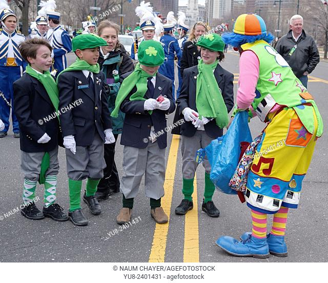 Clown handing out gifts to children, Saint Patrick day parade, Philadelphia, PA, USA
