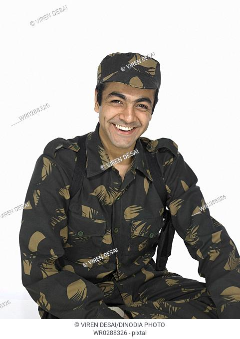 Indian army soldier sitting and looking at camera MR702A