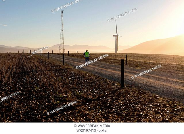 Engineer walking at a wind farm