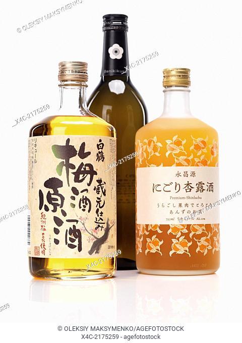 Japanese sweet sake bottles, White crane plum wine umeshu, benikikusui premium plum sake and premium-shinluchu apricot liquor isolated on white background