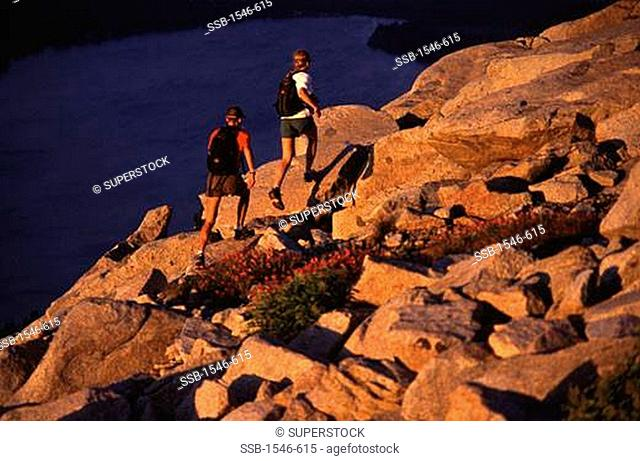 High angle view of two hikers hiking