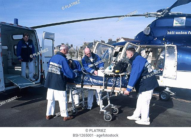 EMERGENCY TRANSPORTATION<BR>Photo essay.<BR>Helicopter rescue. Doctor and emergency medical technicians