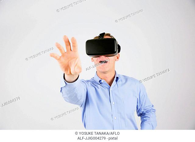 Caucasian man using virtual reality device