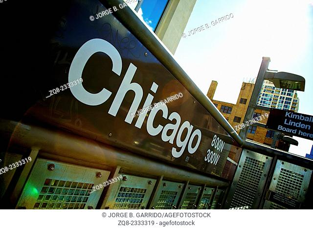 Subway entrance sign at a typical Chicago intersection