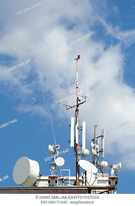 Communication tower with mobilephone antenna