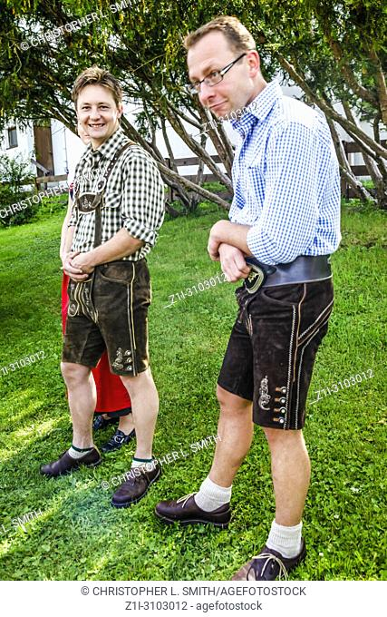 Men in traditional lederhosen tyrolean dress attend Patronage day in Reith bei Seefeld, Austria