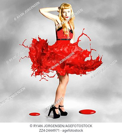 Creative fashion artwork of a gorgeous blond woman dancing in a spray of splashing color. Paint dress pin-up