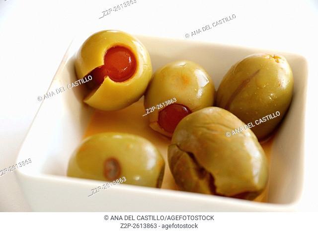 Green olives on white bowl appetizer Spain
