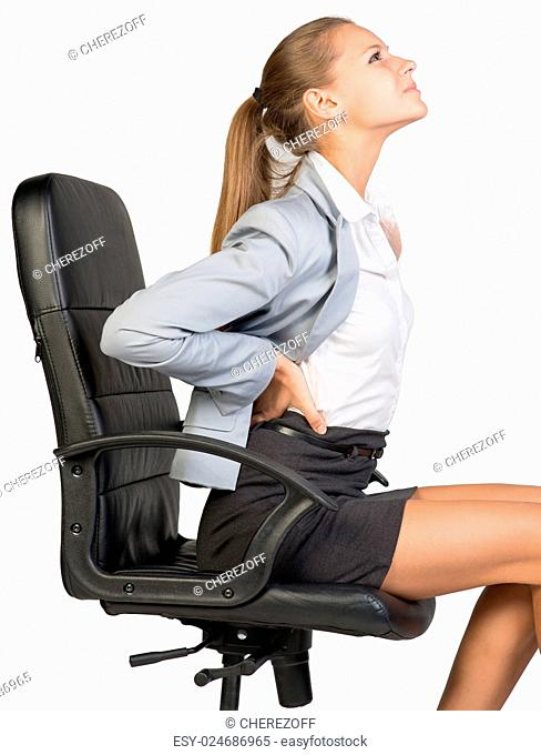 Businesswoman with lower back pain from sitting on office chair. Isolated over white background