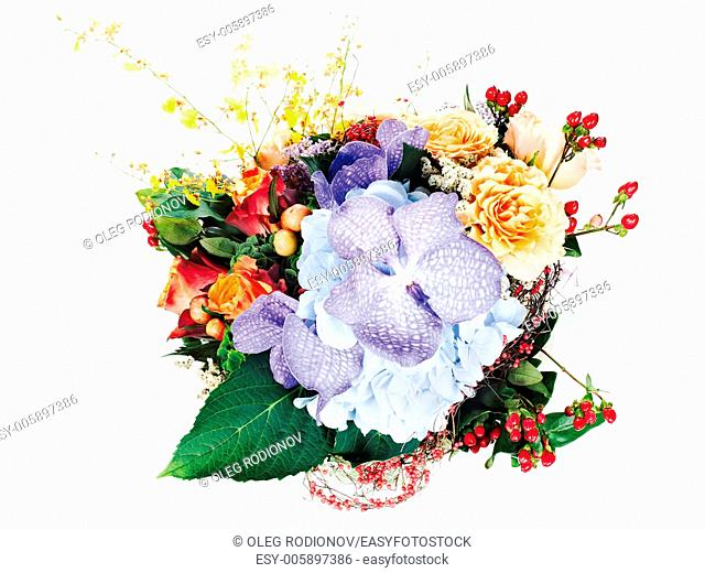 colorful floral arrangement of roses, lilies, freesia, orchids and irises isolated on white background