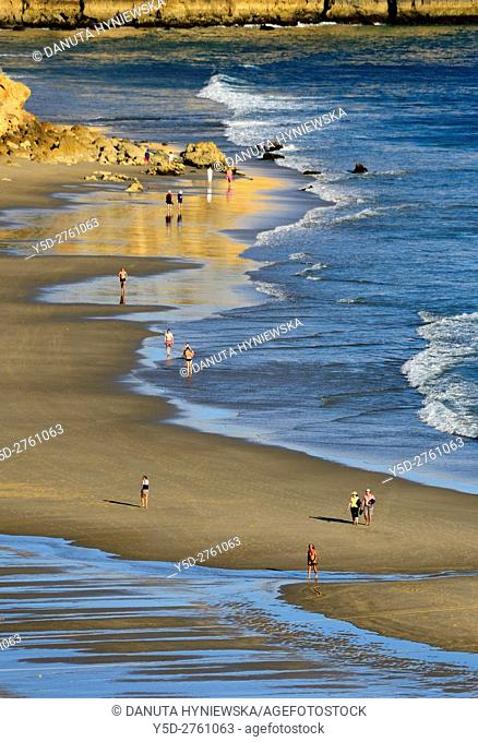 leisure on calm and beautiful Porto de Mos beach, Lagos, Algarve, Portugal, Europe