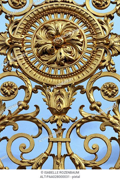 Ornate gold gate, close up