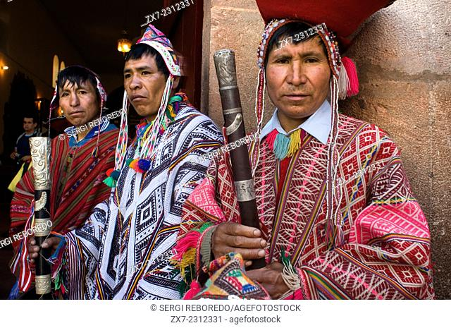 The mountain people dressed in traditional costumes at the door of the church of Pisac Sunday market day. Pisac. Sacred Valley