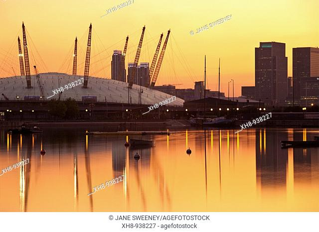 O2 Arena and Canary Wharf buildings reflecting in Royal Victoria Docks, Newham, London, England, UK