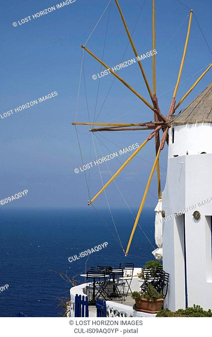View of white washed windmill and sea, Oia, Santorini, Cyclades, Greece